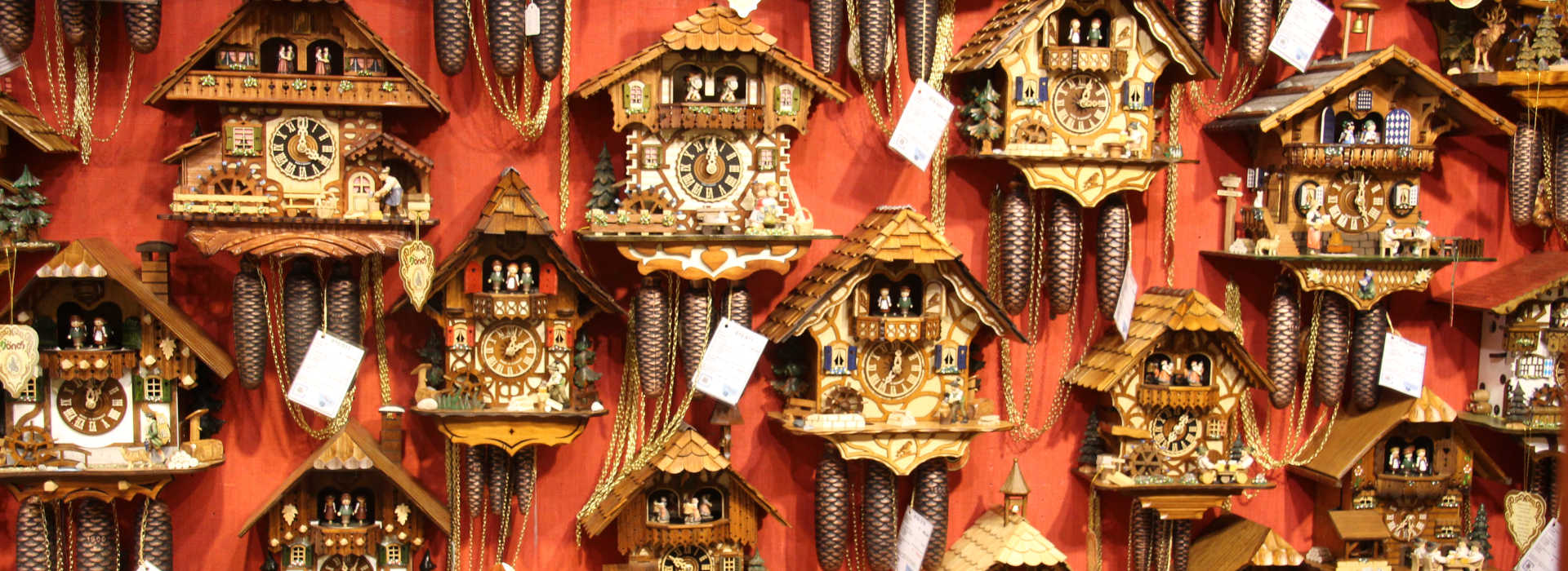 Display of a collection of cuckoo clocks for sale in Bruges, Belgium