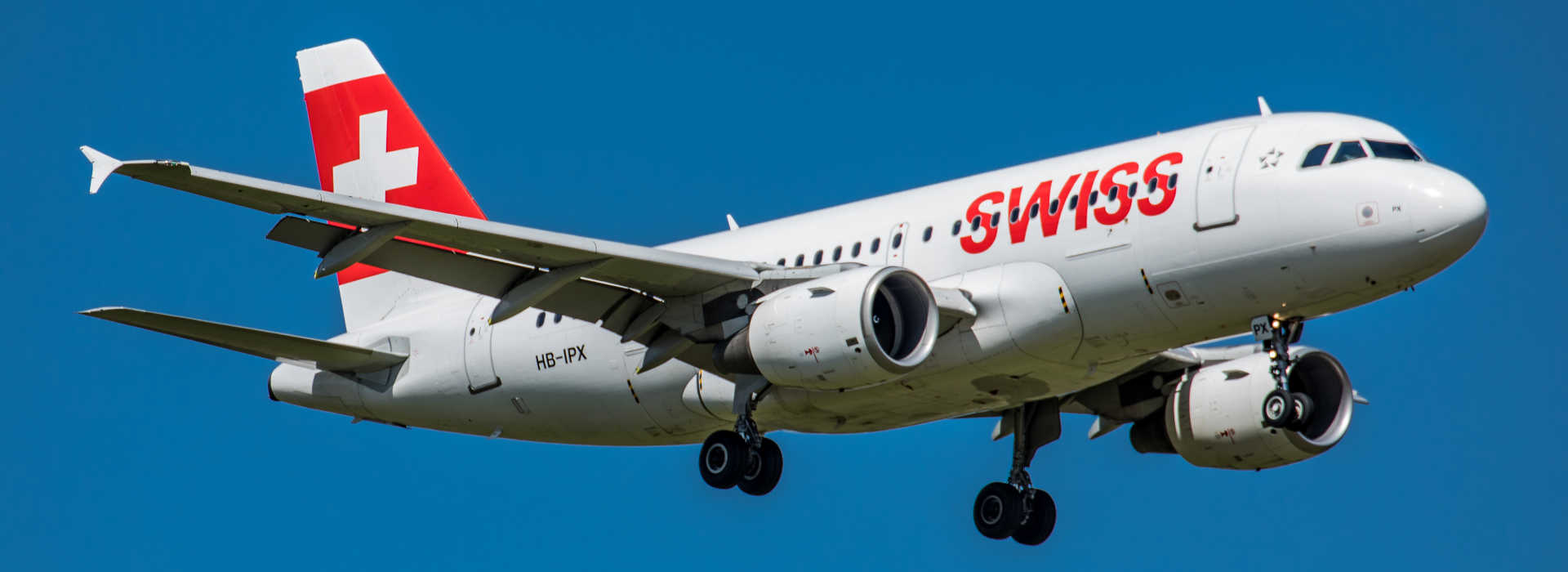 Zurich, Switzerland - August 26, 2018: An Airbus A319-111 of Swiss International Airlines approaching Runway 14 of Zurich Airport. The aircraft with registration HB-IPX was delivered to Swissair on 23rd August 1996. Due to financial problems, this ceased operations in 2002. The aircraft was then taken over by the then newly founded Swiss International Airlines on March 31, 2002.