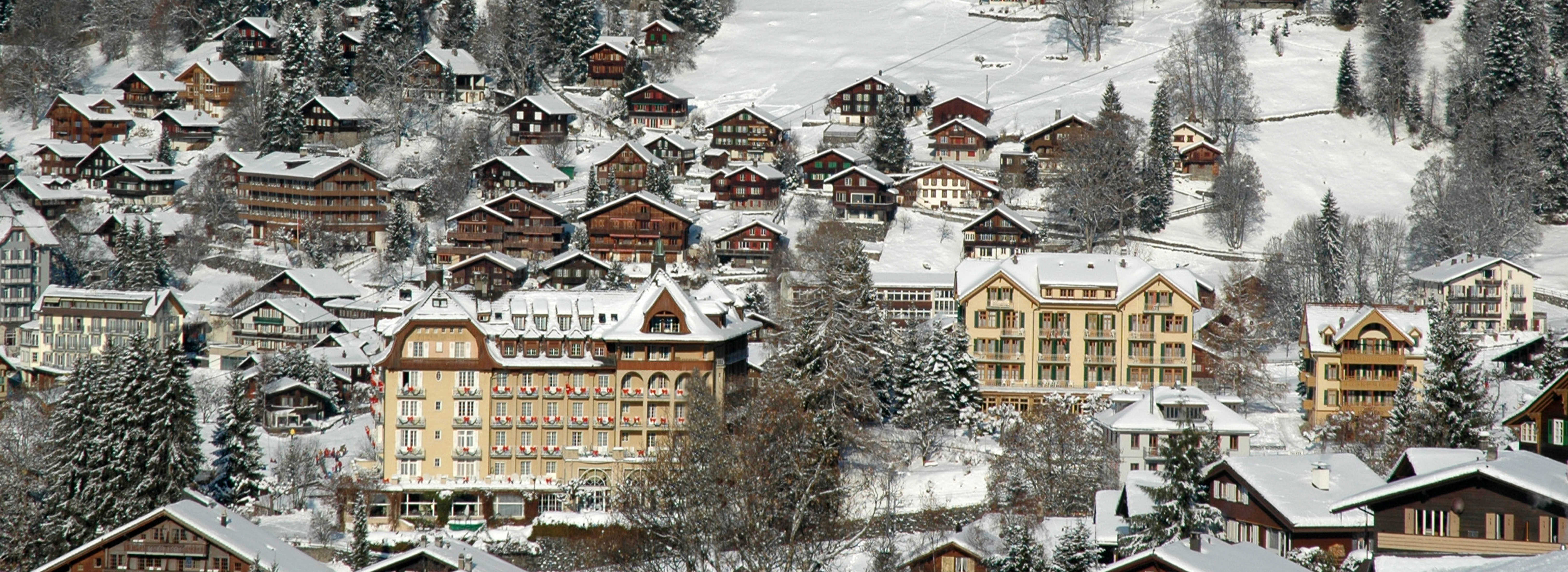 Swiss Village Scene, depicting the snow covered ski resort of Wengen as seen from Allmend, Switzerland